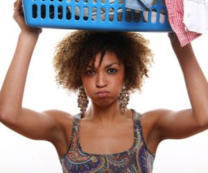 woman-holding-laundry-basket-above-head