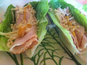 Turkey and lettuce wraps, add mustard for a kick.